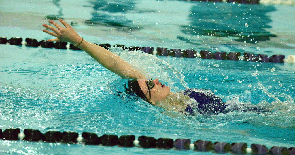 . Mountain View\'s Tasha Reichhardt stretches out her stroke on her way to winning the 100-yard backstroke during Thursday\'s triangular with Berthoud and Holyoke at the Mountain View Aquatic Center. (Mike Brohard/Loveland Reporter-Herald)