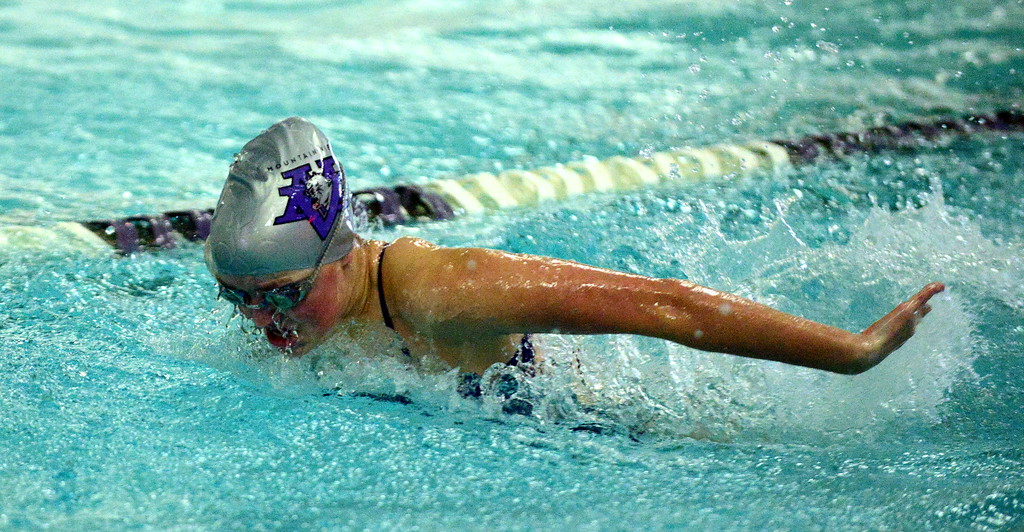 . Mountain View\'s Abby O\'Donnell swims the butterfly leg of the 200-yard medley relay during Thursday\'s triangular with Berthoud and Holyoke at the Mountain View Aquatic Center. (Mike Brohard/Loveland Reporter-Herald)