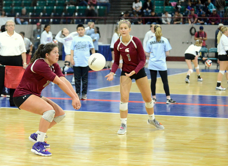 Berthoud's Kailey Berry passes the ball on serve receive during the Spartans' 4A state match with Mead on Thursday at the Denver Coliseum. The 12th-seeded Spartans knocked off No. 5 Mead with a 31-29, 25-15, 26-24 sweep. (Mike Brohard/Loveland Reporter-Herald)