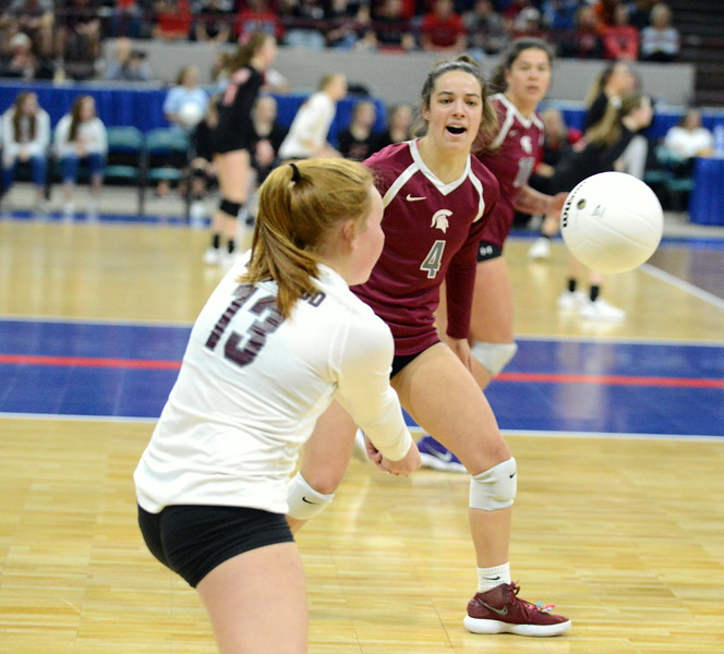 Berthoud's Casady Berry looks on as libero Allison Waller passes the ball during their 4A state match with Mead on Thursday at the Denver Coliseum. The 12th-seeded Spartans knocked off No. 5 Mead with a 31-29, 25-15, 26-24 sweep. (Mike Brohard/Loveland Reporter-Herald)