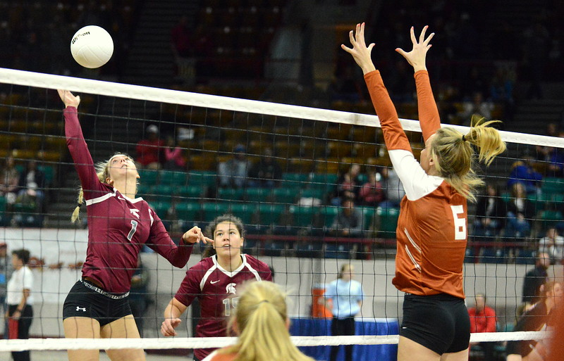 Berthoud's Sophie Kathol goes up for the attack against the block of Mead's Abby Glenn during their 4A state match with Mead on Thursday at the Denver Coliseum. The 12th-seeded Spartans knocked off No. 5 Mead with a 31-29, 25-15, 26-24 sweep. (Mike Brohard/Loveland Reporter-Herald)