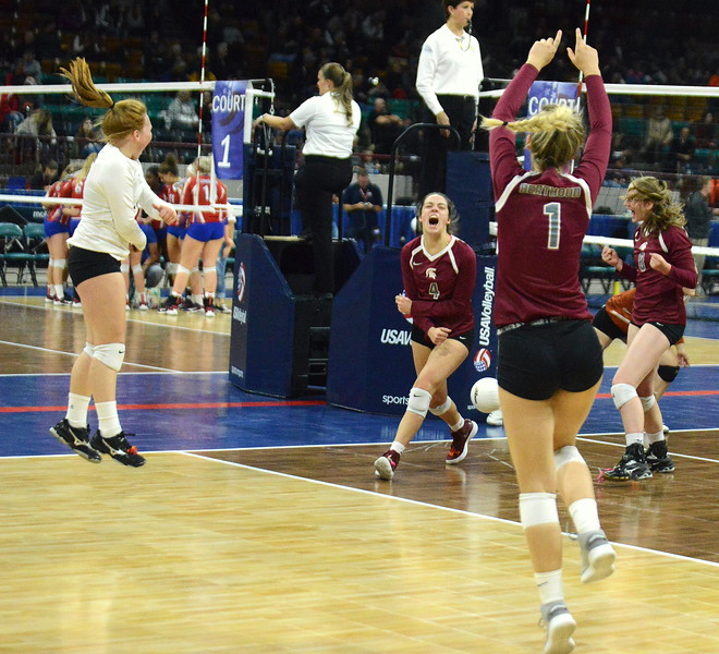 Berthoud celebrates a kill from Casady Berry (4) during their 4A state match with Mead on Thursday at the Denver Coliseum. The 12th-seeded Spartans knocked off No. 5 Mead with a 31-29, 25-15, 26-24 sweep. (Mike Brohard/Loveland Reporter-Herald)