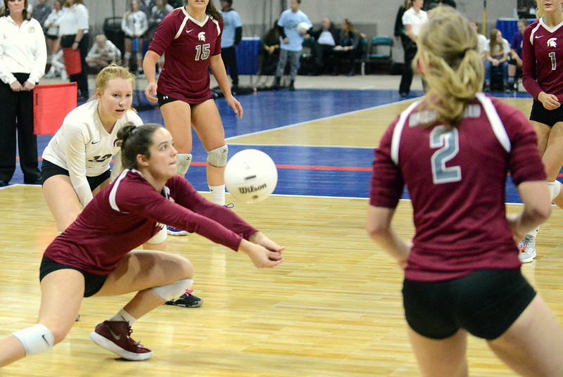 Berthoud's Casady Berry digs up a ball against Longmont in their 4A state tournament match at the Denver Coliseum on Thursday. (Mike Brohard/Loveland Reporter-Herald)