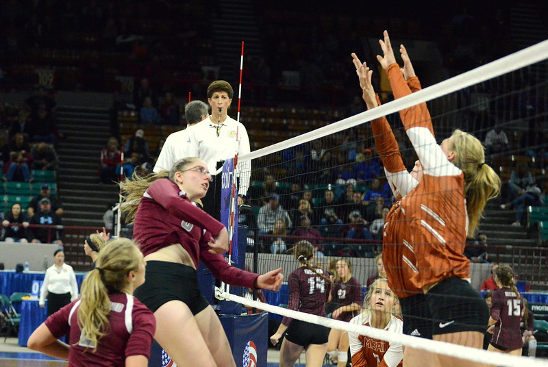 Berthoud's Kathryn Worrell gets her attack through the Mead block during 4A state match with Mead on Thursday at the Denver Coliseum. The 12th-seeded Spartans knocked off No. 5 Mead with a 31-29, 25-15, 26-24 sweep. (Mike Brohard/Loveland Reporter-Herald)
