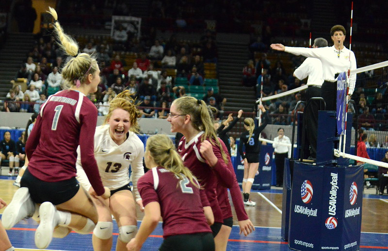 Berthoud celebrates match point of its 4A state match with Mead on Thursday at the Denver Coliseum. The 12th-seeded Spartans knocked off No. 5 Mead with a 31-29, 25-15, 26-24 sweep. (Mike Brohard/Loveland Reporter-Herald)