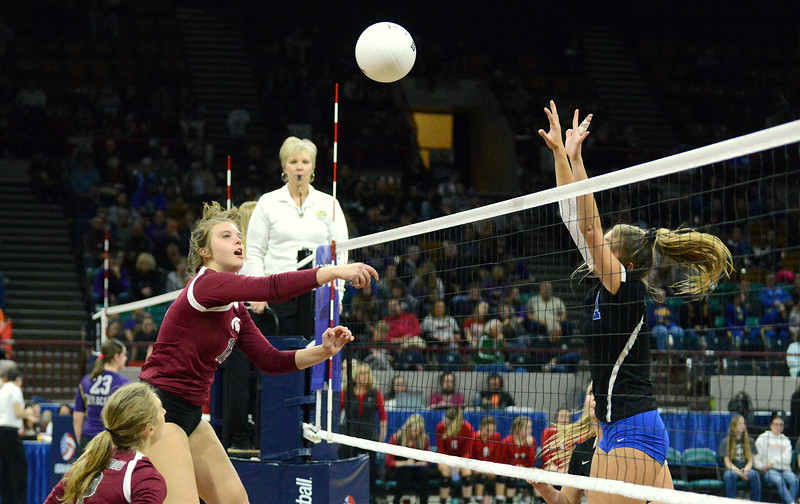 Berthoud's Teagan Holmes goes crosscourt with the attack against the solo block of Longmont's Caroline Demosthenes in their 4A state tournament match at the Denver Coliseum on Thursday. (Mike Brohard/Loveland Reporter-Herald)