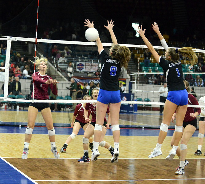 Berthoud's Sophie Kathol goes down the line for a kill, beating the block of Longmont's Ada Grace Creighton (8) and Carolinie Demosthenes (1) in their 4A state tournament match at the Denver Coliseum on Thursday. (Mike Brohard/Loveland Reporter-Herald)
