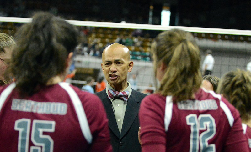 Berthoud coach Mil Santos talks to his team during a timeout in the first set of their 4A state match with Mead on Thursday at the Denver Coliseum. The 12th-seeded Spartans knocked off No. 5 Mead with a 31-29, 25-15, 26-24 sweep. (Mike Brohard/Loveland Reporter-Herald)