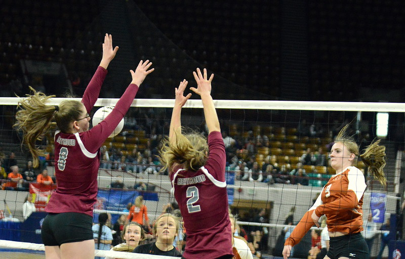 Berthoud's Kathryn Worrell (8) and Trinity Penny get the block on the attack of Mead's Kenzie Morton during their 4A state match with Mead on Thursday at the Denver Coliseum. The 12th-seeded Spartans knocked off No. 5 Mead with a 31-29, 25-15, 26-24 sweep. (Mike Brohard/Loveland Reporter-Herald)