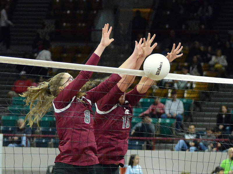 Berthoud's Kathryn Worrell (8) and Kailey Berry (15) team up for the block during their 4A state match with Mead on Thursday at the Denver Coliseum. The 12th-seeded Spartans knocked off No. 5 Mead with a 31-29, 25-15, 26-24 sweep. (Mike Brohard/Loveland Reporter-Herald)