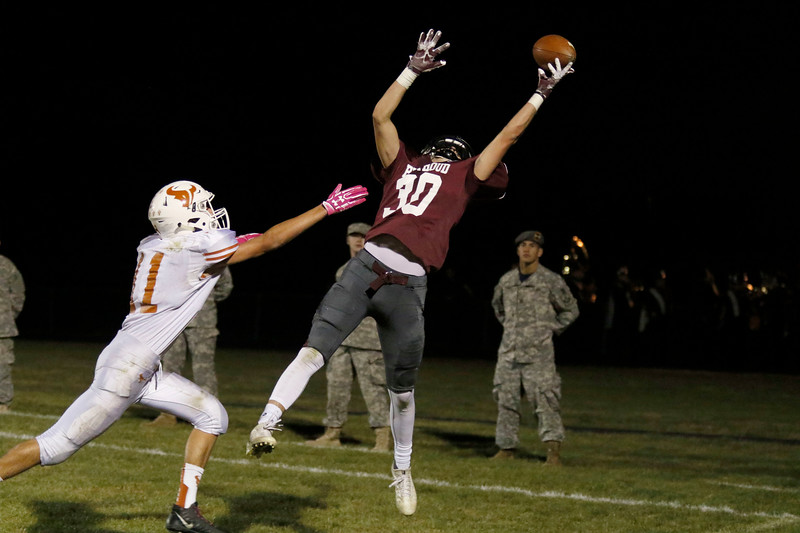 Berthoud's Jake Yuska (30) jumps up to catch a pass at the goal line as Mead's Hunter Payne (11) reaches out to stop him on Friday, Nov. 3, 2017 at Marr Field in Berthoud. (Lauren Cordova/Loveland Reporter-Herald)