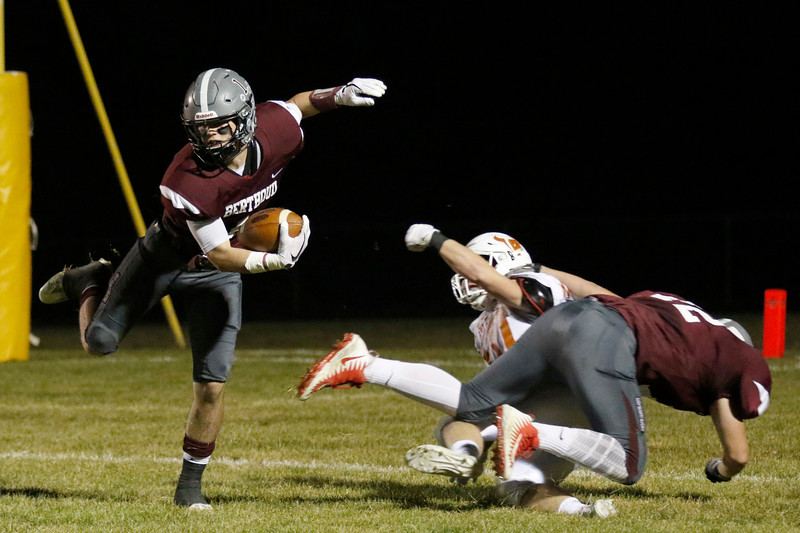 Berthoud's Jacob Lozinski (1) catches the ball near the goal line as Derek Sandstedt (72) blocks Mead's Ryan Lavanchy (10) on Friday, Nov. 3, 2017 at Marr Field in Berthoud. (Lauren Cordova/Loveland Reporter-Herald)