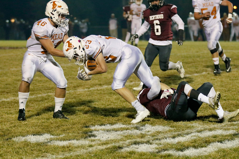 Berthoud's Austyn Binkly (4) tackles Mead's Jake Wachter (23) at the 30-yard line on Friday, Nov. 3, 2017 at Marr Field in Berthoud. (Lauren Cordova/Loveland Reporter-Herald)