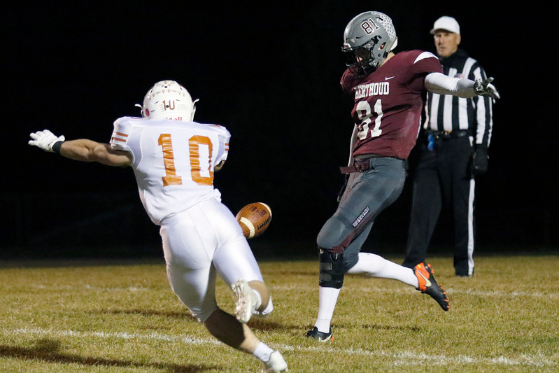 Berthoud's Ryan Schmad (81) punts the ball as Mead's Ryan Lavanchy (10) tries to block the kick on Friday, Nov. 3, 2017 at Marr Field in Berthoud. (Lauren Cordova/Loveland Reporter-Herald)
