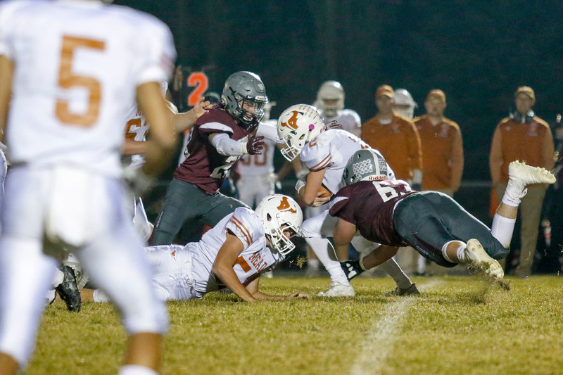 Berthoud's Connor Balliet (63) tackles Mead's Tyler Keys (4) as Alex Wiese (23) comes in for the assist on Friday, Nov. 3, 2017 at Marr Field in Berthoud. (Lauren Cordova/Loveland Reporter-Herald)