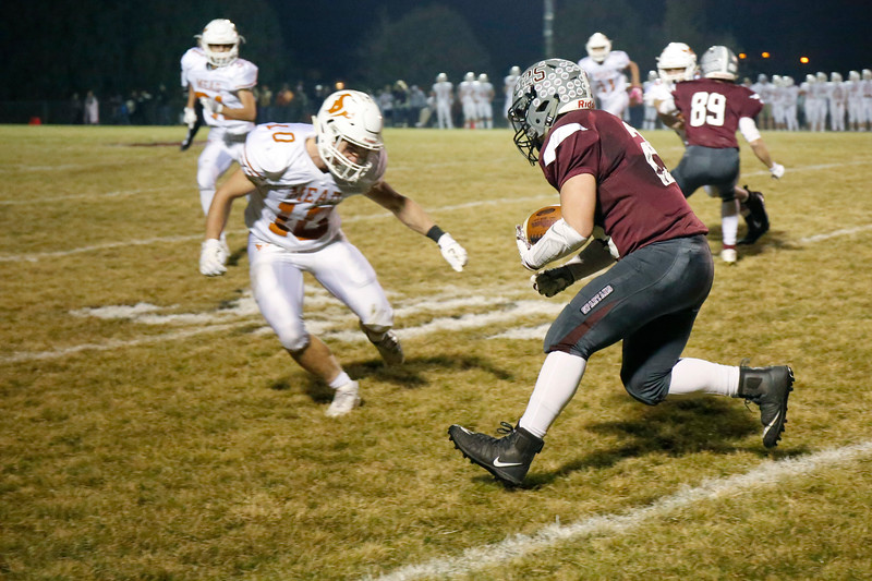 Berthoud's AJ Anema (25) goes up against Mead's Ryan Lavanchy (10) as he runs the ball toward the goal line on Friday, Nov. 3, 2017 at Marr Field in Berthoud. (Lauren Cordova/Loveland Reporter-Herald)