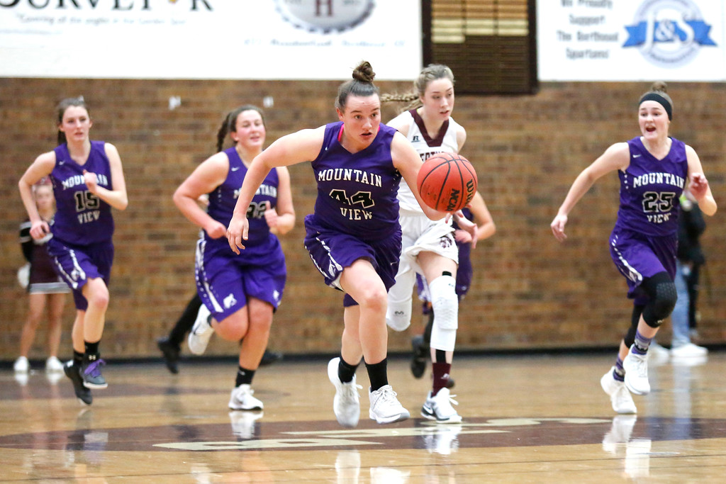 . Mountain View�s RaLeigh Basart (44) runs the ball across the court with her teamates guarding her from Berthoud�s McKayla Milan (52) on Wednesday, Dec. 6, 2017, at Berthoud High School. (Photo by Lauren Cordova/Loveland Reporter-Herald)