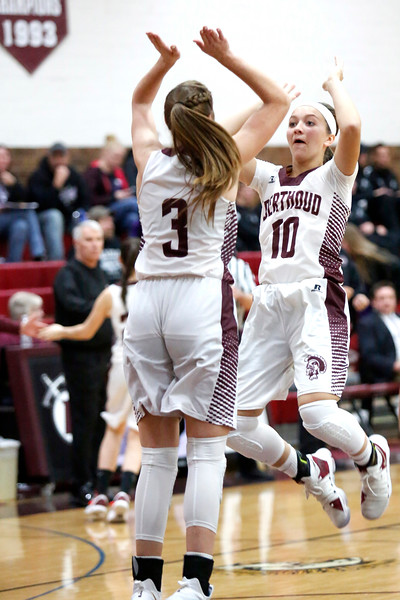 Berthoud's Sydney Meis (10) high-fives teammate Emily Cavey (3) before their game against Mountain View on Wednesday, Dec. 6, 2017, at Berthoud High School. (Photo by Lauren Cordova/Loveland Reporter-Herald)