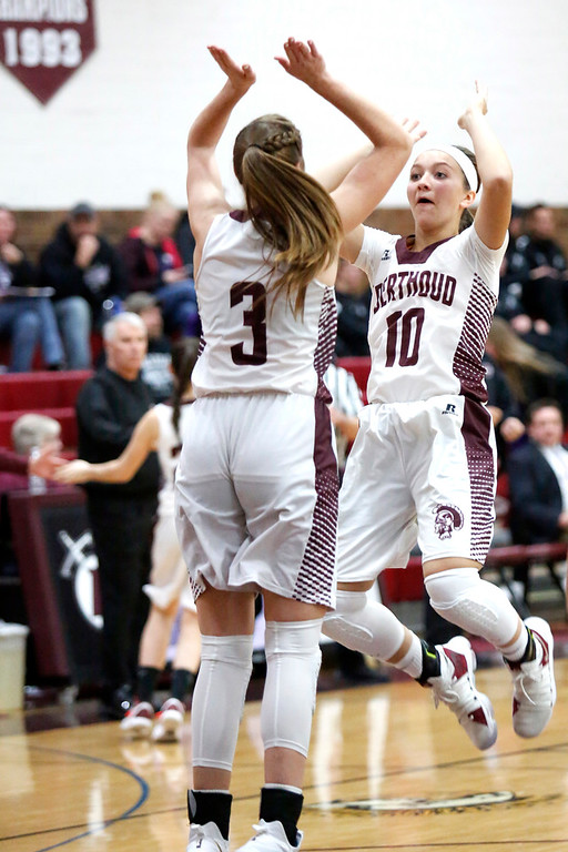 . Berthoud�s Sydney Meis (10) high-fives teammate Emily Cavey (3) before their game against Mountain View on Wednesday, Dec. 6, 2017, at Berthoud High School. (Photo by Lauren Cordova/Loveland Reporter-Herald)