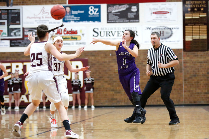 Mountain View's Kali Kelley (1) throws the ball into her teammate while Berthoud's Ashlee Burdette (30) and Fallon Stickley (25) try to intercept the ball on Wednesday, Dec. 6, 2017, at Berthoud High School. (Photo by Lauren Cordova/Loveland Reporter-Herald)