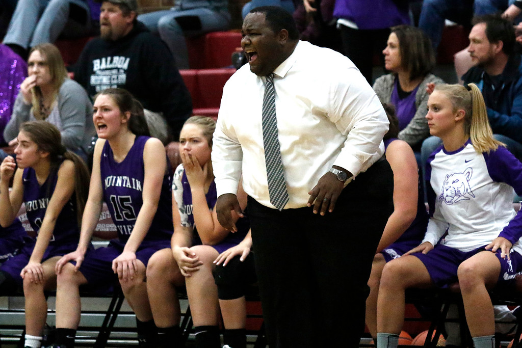 . Mountain View�s coach Jason Walker cheers on his team on Wednesday, Dec. 6, 2017, at Berthoud High School. (Photo by Lauren Cordova/Loveland Reporter-Herald)