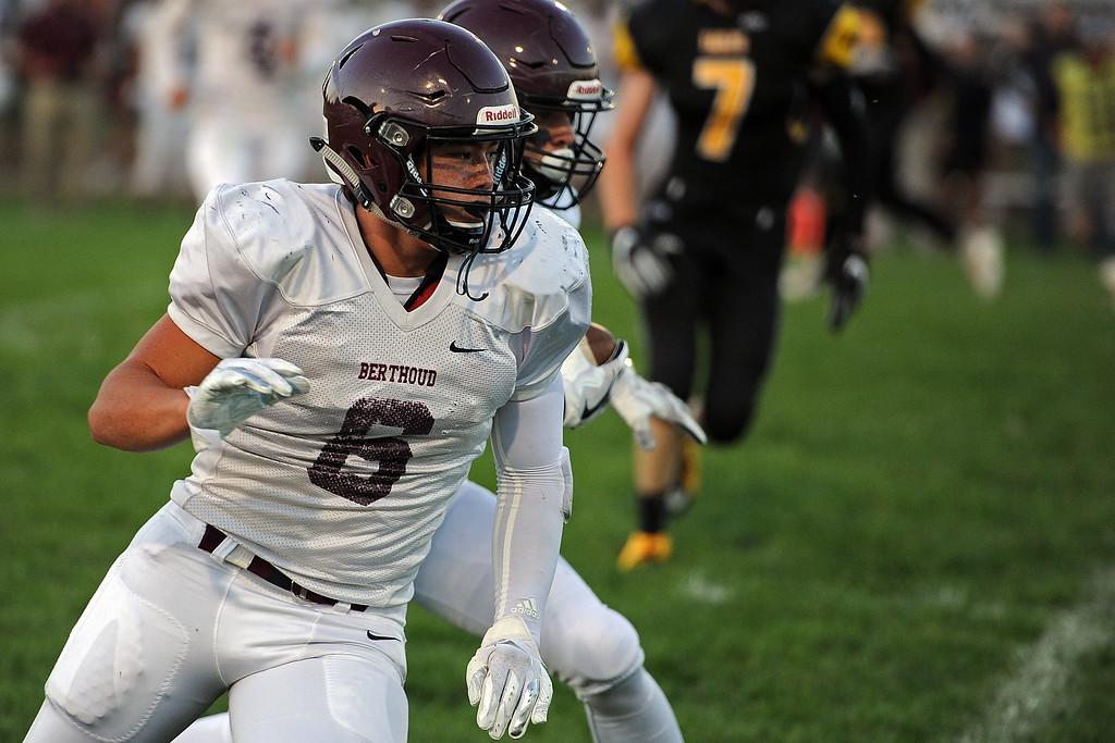 . Berthoud\'s Anthony Trojahn (6) looks to block for teammate Danny Pelphrey during a game Friday, Sept. 14, 2018 at Patterson Stadium in Loveland, Colorado. (Sean Star/Loveland Reporter-Herald)