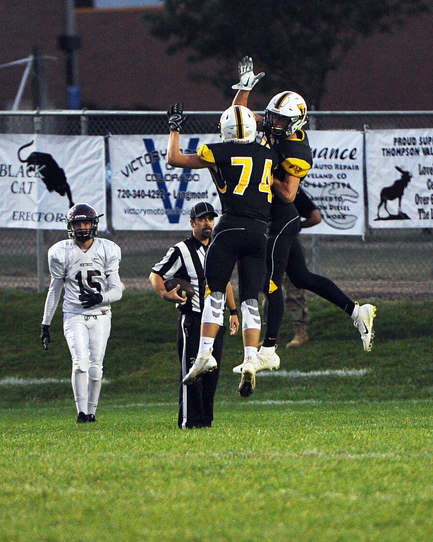 . A pair of Thompson Valley teammates celebrate a touchdown during a game Friday, Sept. 14, 2018 at Patterson Stadium in Loveland, Colorado. (Sean Star/Loveland Reporter-Herald)
