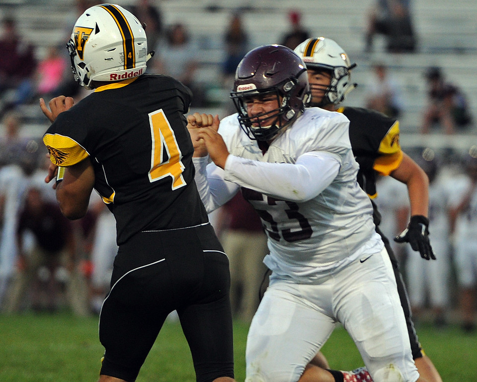 . Berthoud\'s Ty Beaman (53) shoves Thompson Valley\'s Cameron Nellor during a game Friday, Sept. 14, 2018 at Patterson Stadium in Loveland, Colorado. (Sean Star/Loveland Reporter-Herald)