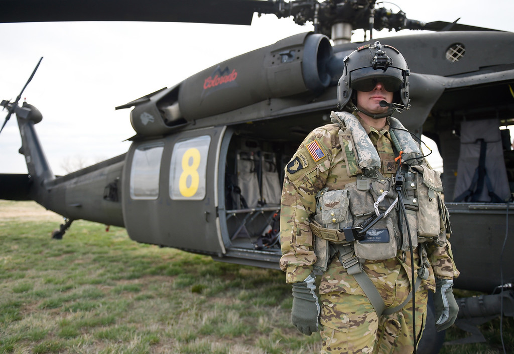 . LONGMONT, CO - APRIL 2: Colorado Army National Guard SFC Marc Belo watches a Chinook helicopter fly over Vance Brand Airport Tuesday morning, April 2, 2019. The Colorado Army National Guard is conducting live bucket training for the next several days at Longmont\'s Ralph Price Reservoir at Button Rock Preserve, four miles west of Lyons. Button Rock will be closed during the training. To view more photos visit timescall.com. (Photo by Lewis Geyer/Staff Photographer)