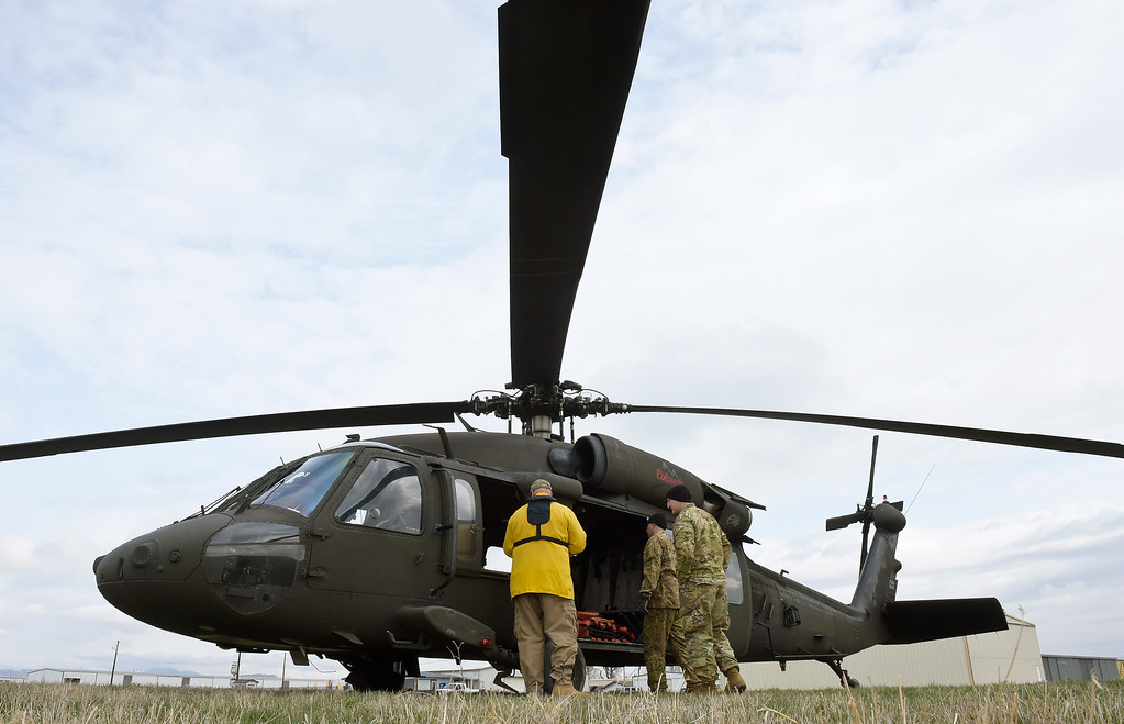 . LONGMONT, CO - APRIL 2: A Black Hawk helicopter crew prepares to fly out of Vance Brand Airport Tuesday morning, April 2, 2019. The Colorado Army National Guard is conducting live bucket training for the next several days at Longmont\'s Ralph Price Reservoir at Button Rock Preserve, four miles west of Lyons. Button Rock will be closed during the training. To view more photos visit timescall.com. (Photo by Lewis Geyer/Staff Photographer)