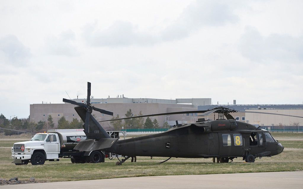 . LONGMONT, CO - APRIL 2: A Black Hawk helicopter is refueled at Vance Brand Airport Tuesday morning, April 2, 2019. The Colorado Army National Guard is conducting live bucket training for the next several days at Longmont\'s Ralph Price Reservoir at Button Rock Preserve, four miles west of Lyons. Button Rock will be closed during the training. To view more photos visit timescall.com. (Photo by Lewis Geyer/Staff Photographer)