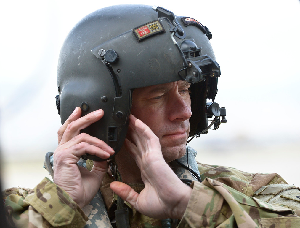 . LONGMONT, CO - APRIL 2: Colorado Army National Guard SFC Marc Belo prepares for flight at Vance Brand Airport Tuesday morning, April 2, 2019. The Colorado Army National Guard is conducting live bucket training for the next several days at Longmont\'s Ralph Price Reservoir at Button Rock Preserve, four miles west of Lyons. Button Rock will be closed during the training. To view more photos visit timescall.com. (Photo by Lewis Geyer/Staff Photographer)