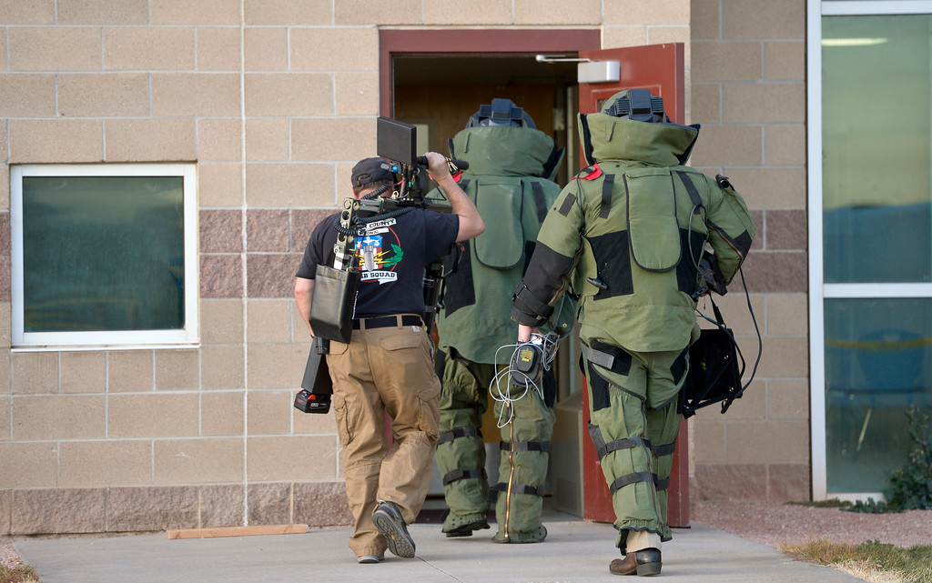 """. Members of the Boulder County Bomb Squad enter he \""""E\"""" wing of Silver Creek High School, 4901 Nelson Rd., Wednesday afternoon. To view more photos visit timescall.com. Lewis Geyer/Staff Photographer Nov. 29, 2017"""