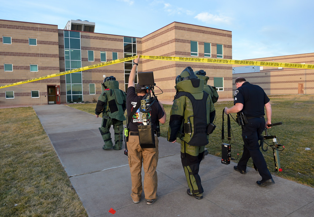 """. Members of the Boulder County Bomb Squad enter the \""""E\"""" wing at Silver Creek High School, 4901 Nelson Rd., Wednesday afternoon. To view more photos visit timescall.com. Lewis Geyer/Staff Photographer Nov. 29, 2017"""