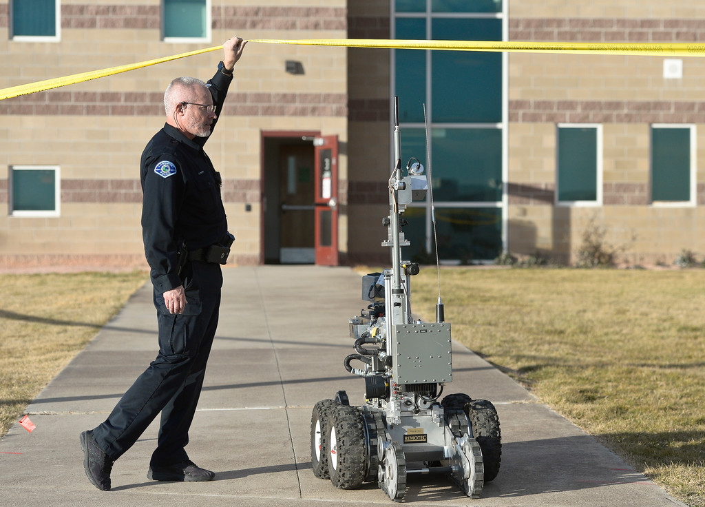 """. A Boulder County Bomb Squad robot enters the \""""E\"""" wing of Silver Creek High School, 4901 Nelson Rd., Wednesday afternoon. To view more photos visit timescall.com. Lewis Geyer/Staff Photographer Nov. 29, 2017"""