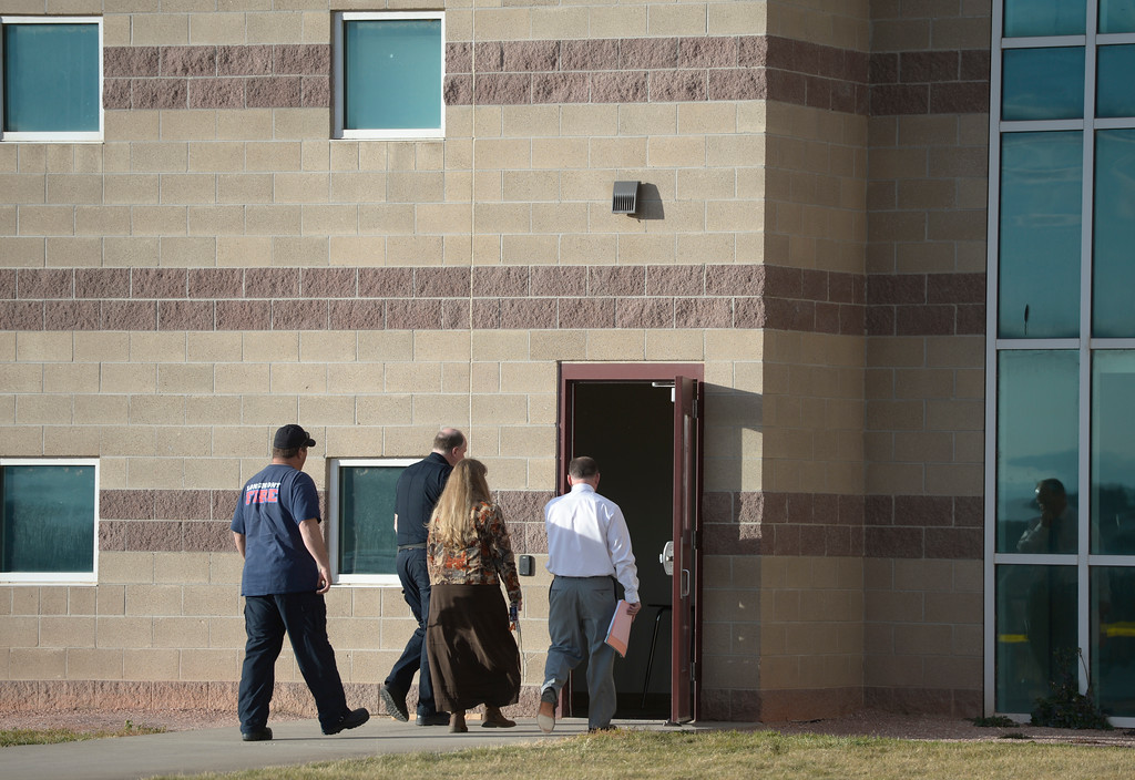 """. Teachers and administrators who had to enter the \""""E\"""" wing at Silver Creek High School were escorted by law enforcement officials Wednesday afternoon. To view more photos visit timescall.com. Lewis Geyer/Staff Photographer Nov. 29, 2017"""