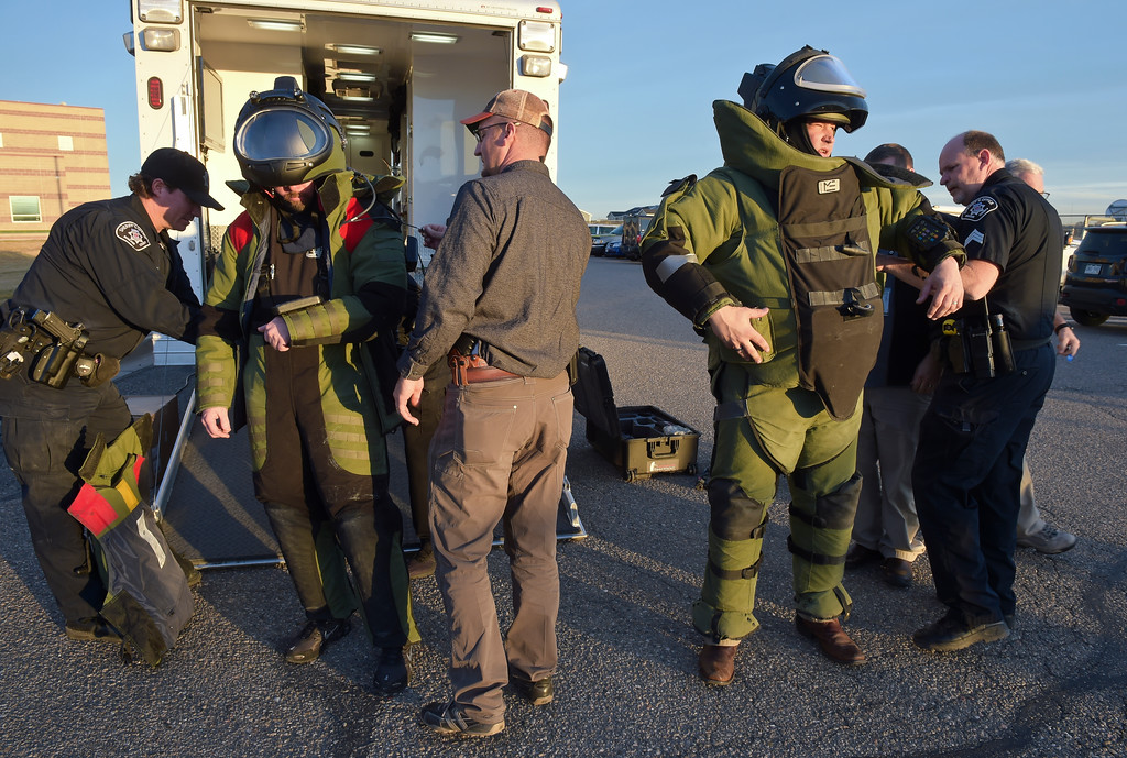 . Members of the Boulder County Bomb Squad prepare to search Silver Creek High School, 4901 Nelson Rd., Wednesday afternoon. To view more photos visit timescall.com. Lewis Geyer/Staff Photographer Nov. 29, 2017