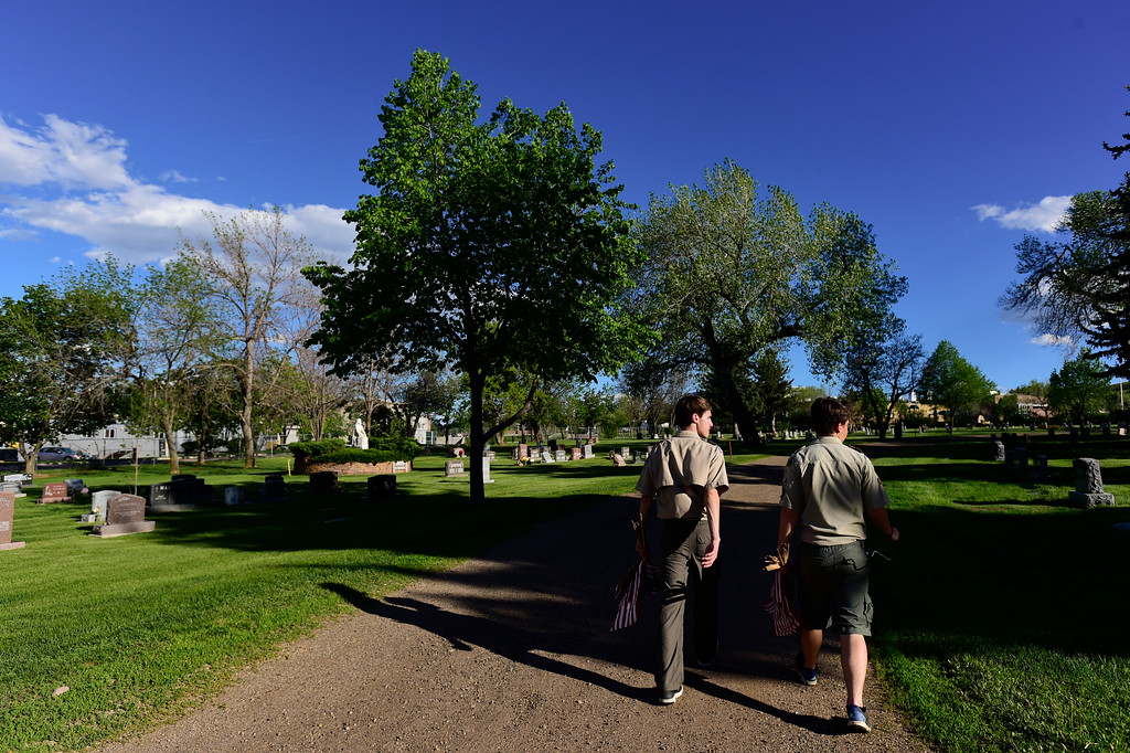 . From left: Boy Scouts Erik West and Evan Stuber, both of Troop 77 Boulder Elks Lodge, search for the headstones of veterans at Green Mountain Cemetery in Boulder on Wednesday. Boy Scouts from Troop 77 placed flags on more than 480 graves of veterans from all branches of the armed services spanning from the Spanish American War to the present. More photos: DailyCamera.com. Matthew Jonas/Staff Photographer May 24,  20