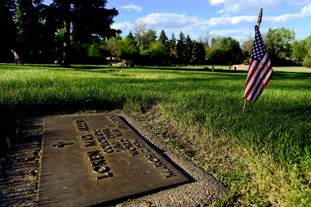 . A headstone from a World War II veteran is seen at Green Mountain Cemetery in Boulder on Wednesday. Boy Scouts from Troop 77 placed flags on more than 480 graves of veterans from all branches of the armed services spanning from the Spanish American War to the present. More photos: DailyCamera.com. Matthew Jonas/Staff Photographer May 24,  20