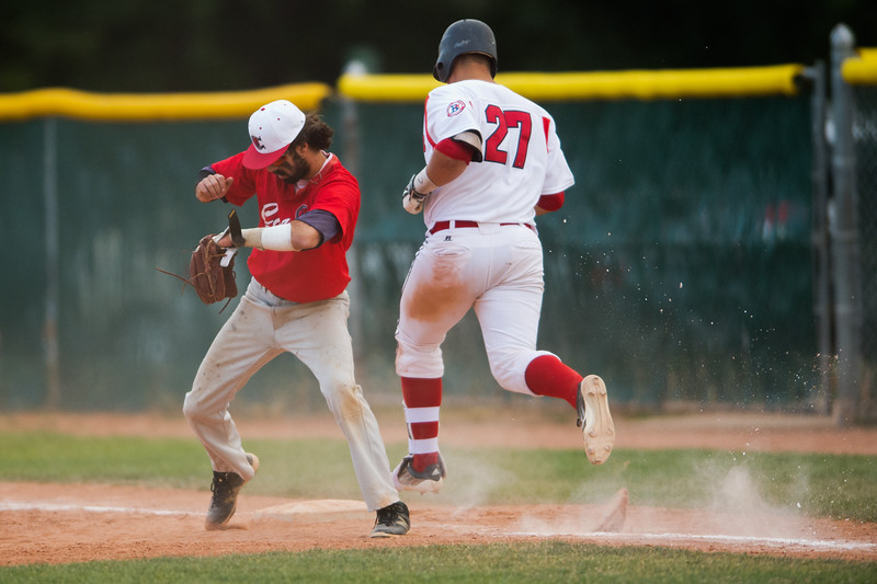 """Boulder Collegians' Conor Behrens is tagged out on first base during the game against the Laramie Colts at Scott Carpenter Field in Boulder on Wednesday.<br /> More photos:  <a href=""""http://www.BoCoPreps.com"""">http://www.BoCoPreps.com</a><br /> (Autumn Parry/Staff Photographer)<br /> July 13, 2016"""
