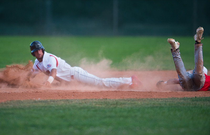 "Laramie Colts' Tre Snow (right) tagged out Boulder Collegians' Jaron Balman as he slid into second base during the game at Scott Carpenter Field in Boulder on Wednesday.<br /> More photos:  <a href=""http://www.BoCoPreps.com"">http://www.BoCoPreps.com</a><br /> (Autumn Parry/Staff Photographer)<br /> July 13, 2016"
