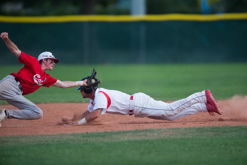 "Laramie Colts' Tre Snow tags out Boulder Collegians' Jaron Balman as he slides into second base during the game at Scott Carpenter Field in Boulder on Wednesday.<br /> More photos:  <a href=""http://www.BoCoPreps.com"">http://www.BoCoPreps.com</a><br /> (Autumn Parry/Staff Photographer)<br /> July 13, 2016"