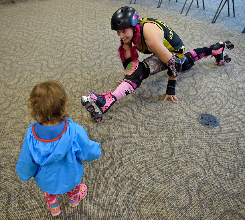 ". Zoe ""Pink Bang Theory\"" Roberts does the splits for Leona Downey, 16 mos., at the Longmont Public Library Wednesday morning. Several members of the Boulder County Bombers roller derby team read books pertaining to bullying, self confidence, feelings during the children\'s story time. \""We are now officially the coolest library in Boulder County if not Colorado,\"" said Electra Greer, head of children and teen services. To view more photos visit timescall.com.  Lewis Geyer/Staff Photographer Oct. 04, 2017"