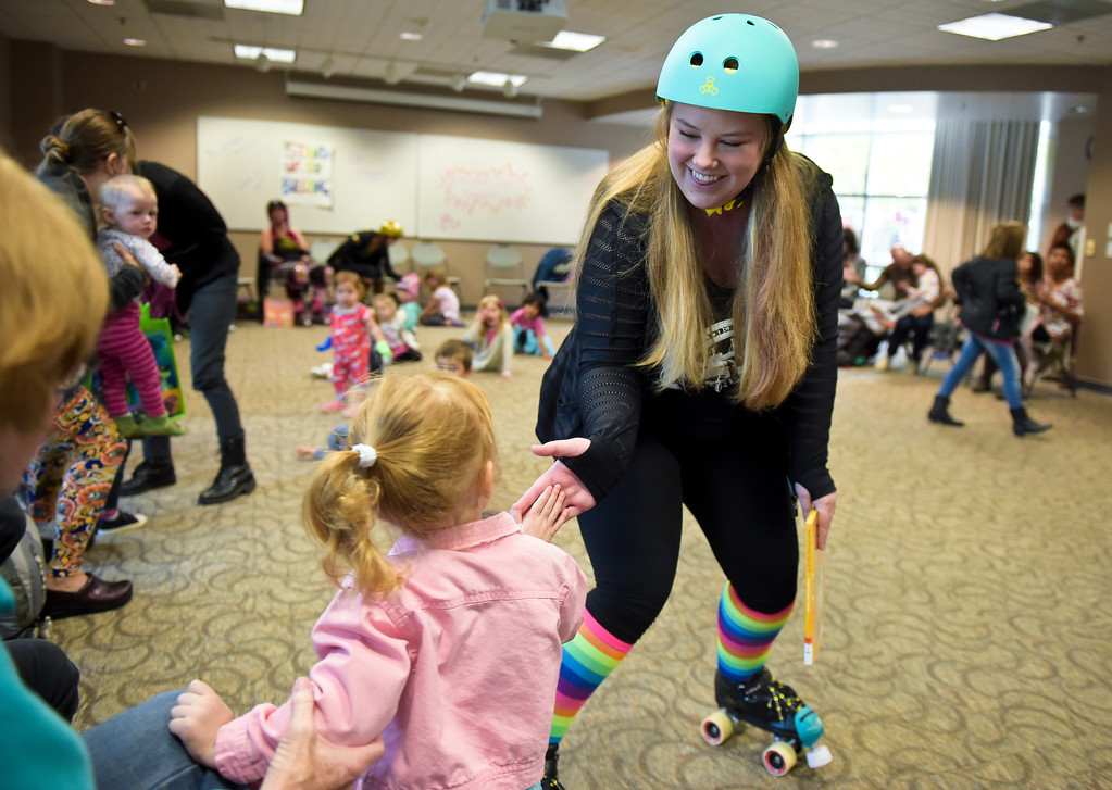 ". Kelsie ""Mad Astra\"" Miller gets high fives after reading at the Longmont Public Library Wednesday morning. Several members of the Boulder County Bombers roller derby team read books pertaining to bullying, self confidence, feelings during the children\'s story time. \""We are now officially the coolest library in Boulder County if not Colorado,\"" said Electra Greer, head of children and teen services. To view more photos visit timescall.com.  Lewis Geyer/Staff Photographer Oct. 04, 2017"