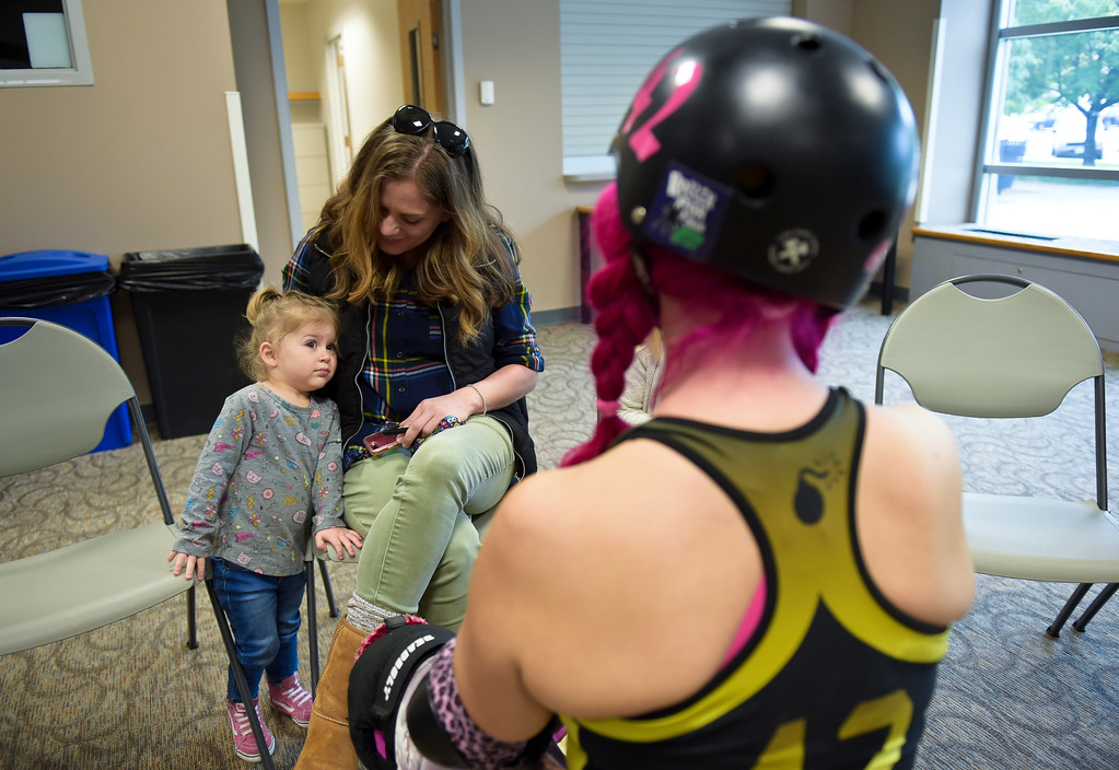 ". Lolo, 2, and her mother Kate Foster meet Zoe ""Pink Bang Theory\"" Roberts at the Longmont Public Library Wednesday morning. Several members of the Boulder County Bombers roller derby team read books pertaining to bullying, self confidence, feelings during the children\'s story time. \""We are now officially the coolest library in Boulder County if not Colorado,\"" said Electra Greer, head of children and teen services. To view more photos visit timescall.com.  Lewis Geyer/Staff Photographer Oct. 04, 2017"