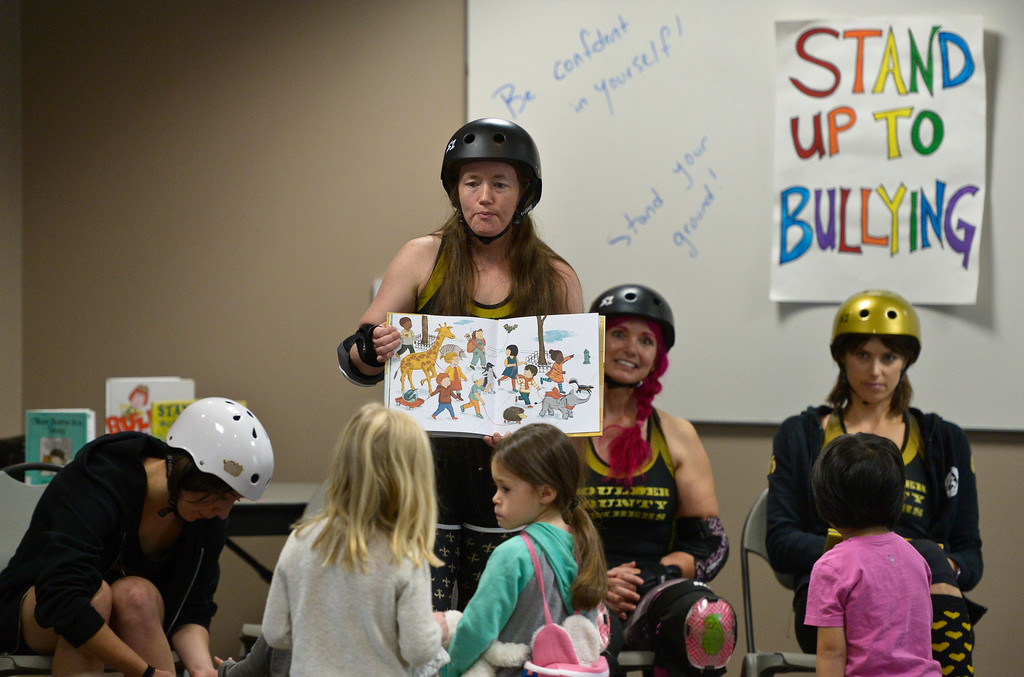 ". Nicole ""Fleur de Beast\"" LeBoeuf-Little reads to children at the Longmont Public Library Wednesday morning. Several members of the Boulder County Bombers roller derby team read books pertaining to bullying, self confidence, feelings during the children\'s story time. \""We are now officially the coolest library in Boulder County if not Colorado,\"" said Electra Greer, head of children and teen services. To view more photos visit timescall.com.  Lewis Geyer/Staff Photographer Oct. 04, 2017"