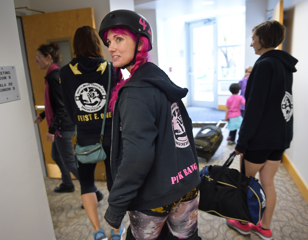 ". Zoe ""Pink Bang Theory\"" Roberts skates into the meeting room at the Longmont Public Library Wednesday morning. Several members of the Boulder County Bombers roller derby team read books pertaining to bullying, self confidence, feelings during the children\'s story time. \""We are now officially the coolest library in Boulder County if not Colorado,\"" said Electra Greer, head of children and teen services. To view more photos visit timescall.com.  Lewis Geyer/Staff Photographer Oct. 04, 2017"