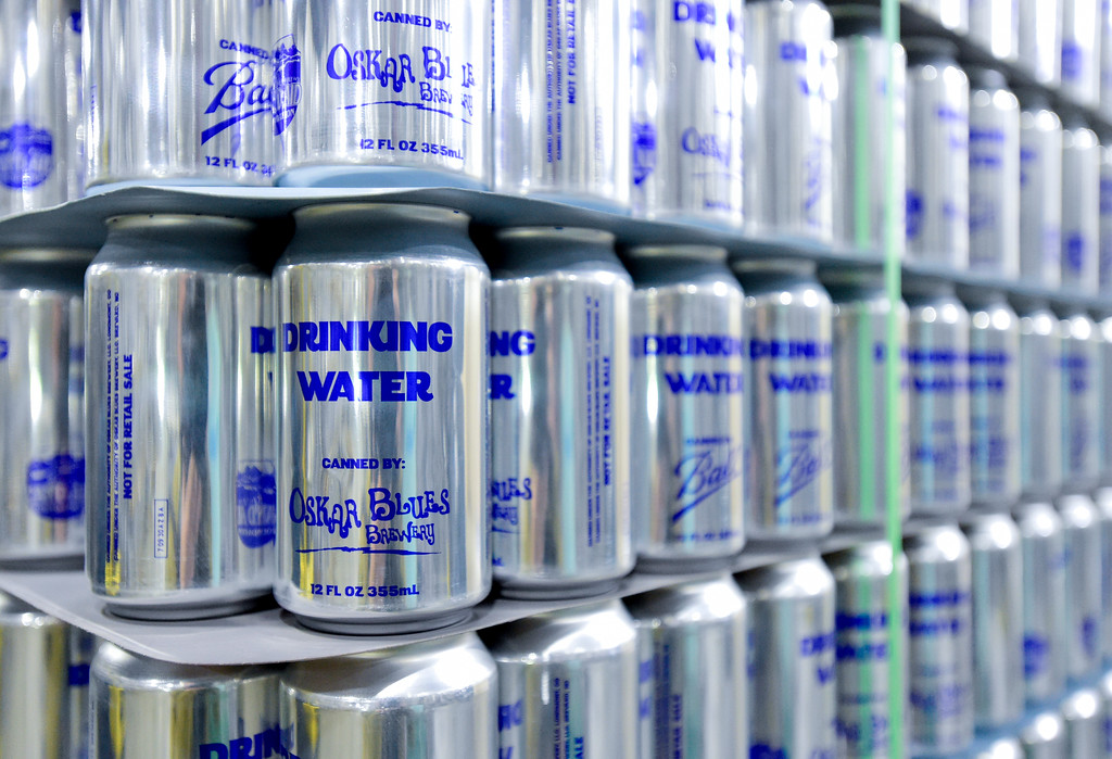 . Aluminum cans for water that are donated to people in areas that have been hit by natural disasters are seen stacked at the Oskar Blues brewery in Longmont, Colorado on Oct. 3, 2017. (Photo by Matthew Jonas/Times-Call)