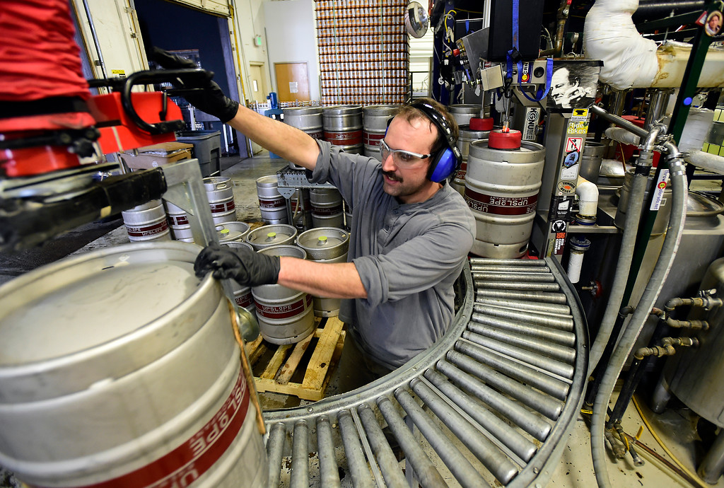 . Corey Kenner works to fill kegs at Upslope Brewing on Monday in Boulder. For more photos of activity at Upslope Brewing go to dailycamera.com Jeremy Papasso/ Staff Photographer/ Oct. 9, 2017
