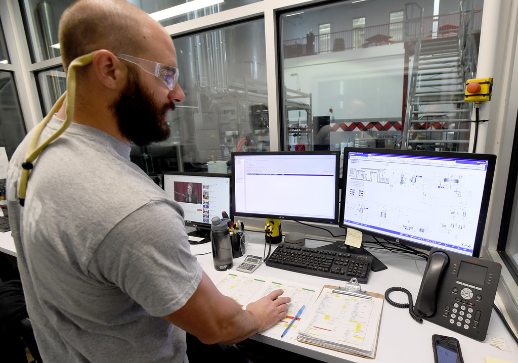 . Head brewer, Fred Rizzo, monitors the Avery Brewing main brewing floor at the operations station. Beer Brewing activity at Avery Brewery in Boulder. Cliff Grassmick  Staff Photographer October 6, 2017